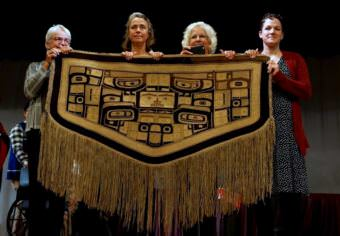 "At least four generations of the Davenport family have grown up with the ""Diving Whale"" blanket. But, as Amy Davenport told the audience Sept. 14, ""There came a time when this blanket needed to come back."" (Photo courtesy James Poulson/Daily Sitka Sentinel)"