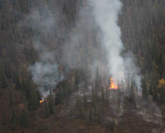 Red Hill Fire continues to burn Saturday evening. The fire, estimated at 1 acre, is approximately 100 miles northeast of Glennallen and 1.8 miles northeast of Chisana. (Photo courtesy Luke Wassick/National Park Service)
