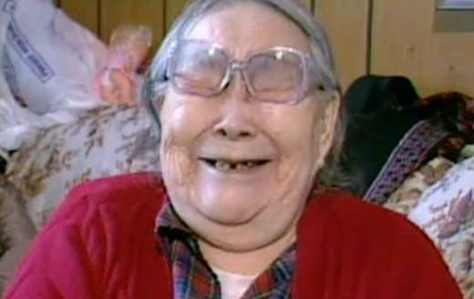 """Mary Worm of Kongiganak laughs while telling a story during KYUK's """"Waves of Wisdom"""" series, featuring interviews with YK Delta elders. This video and others are now available online through the American Archive of Public Broadcasting. (Photo by KYUK)"""