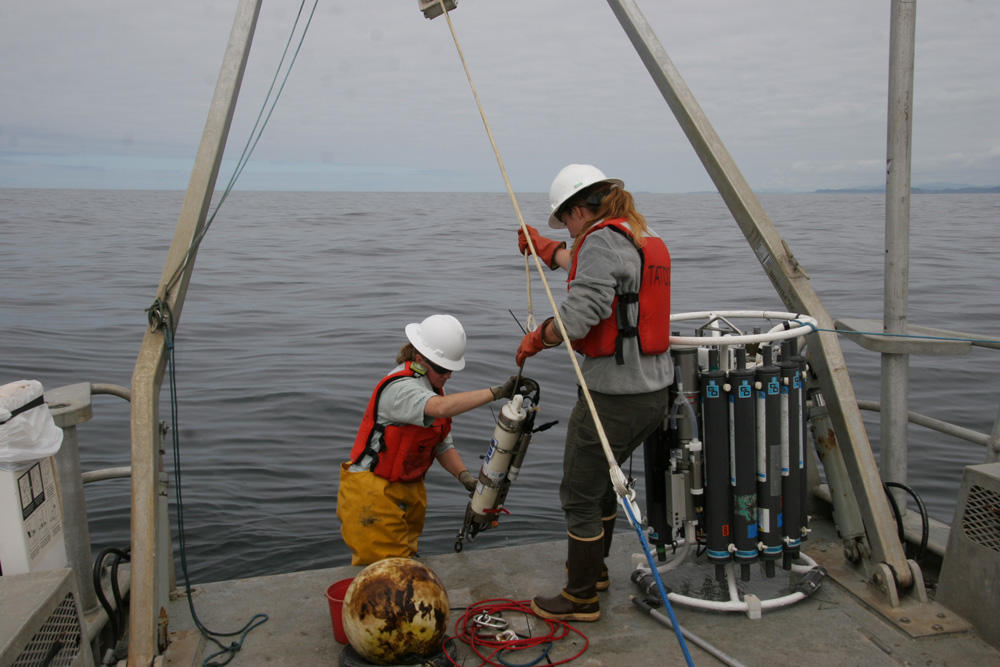Olympic Coast National Marine Sanctuary research team members, Kathy Hough and LTJG Alisha Friel, recover sensors deployed seasonally off the coast of Washington from the research vessel Tatoosh in July 2017. (Photo courtesy S. Maenner/NOAA)