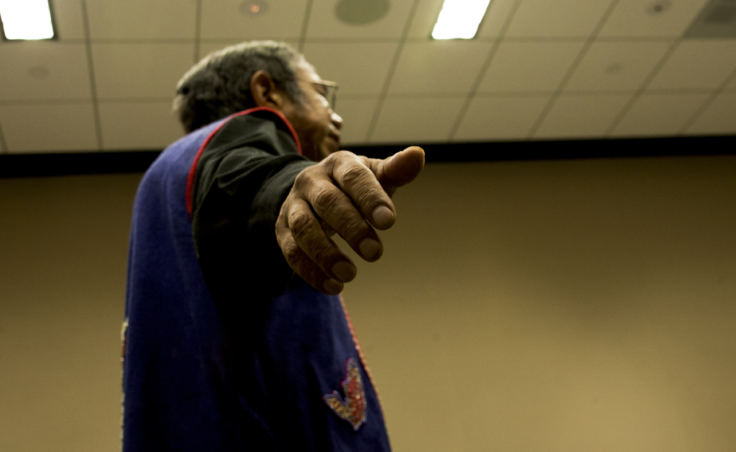 Tlingit storyteller Bob Sam spreads his arms mimicking the flight of a bird while he tells a story Tuesday, Oct. 17, 2017, during a Elders and Youth Conference workshop in Anchorage. (Photo by Tripp J Crouse)