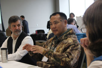 John Hopson, Jr., (r) of Wainright and Rand Hagenstein (l) of The Nature Conservancy joined representatives from oil and gas, mining, environmental groups and local communities at the Walker administration's climate change round table in Anchorage on Oct. 4, 2017. (Photo by Rachel Waldholz/Alaska's Energy Desk)