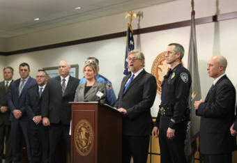 Acting U.S. Attorney Bryan Schroder holds a press conference with other law enforcement officials on Wednesday, Oct. 18, 2017, in Anchorage. They were announcing the roll out of a new anti-violent crime strategy.