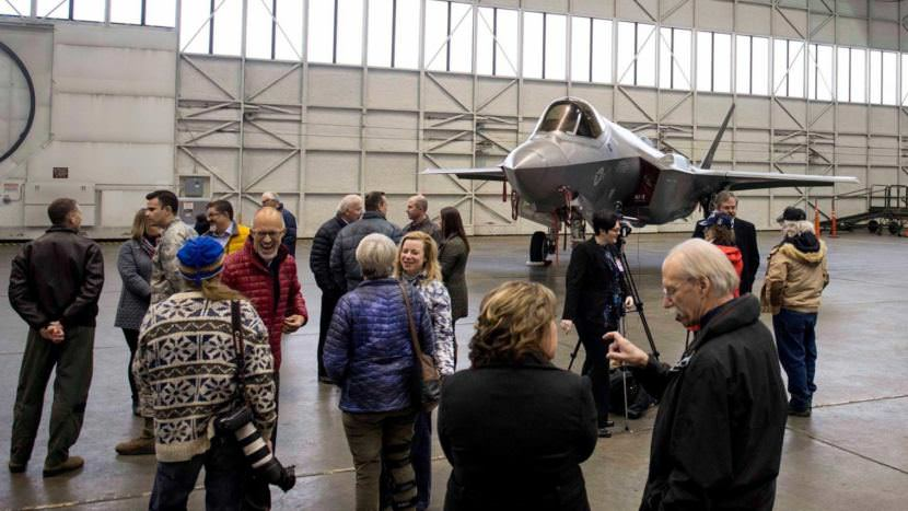 Event attendees mill around an F-35 in an Eielson Air Force Base hangar on Tuesday, Oct. 17, 2017.