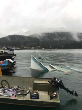 The bow of a partially-submerged vessel pokes out of Gastineau Channel on Saturday, Oct. 21, 2017.