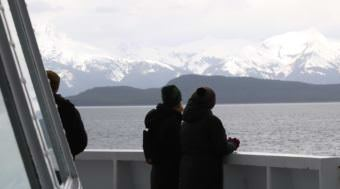 Passengers watch the scenery go by on the ferry Matanuska's forward deck during a May 3, 2017, sailing from Juneau to Haines. (Photo by Aaron Bolton/KSTK)