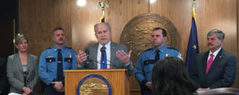 Gov. Bill Walker speaks about his public safety plan. Listening to him are: Alaska Attorney General Jahna Lindemuth, Alaska State Troopers Director Col. Hans Brinke, Alaska Wildlife Troopers Director Col. Steve Hall, and Public Safety Commissioner Walt Monegan, on Oct. 30, 2017. (Photo by Andrew Kitchenman/KTOO)