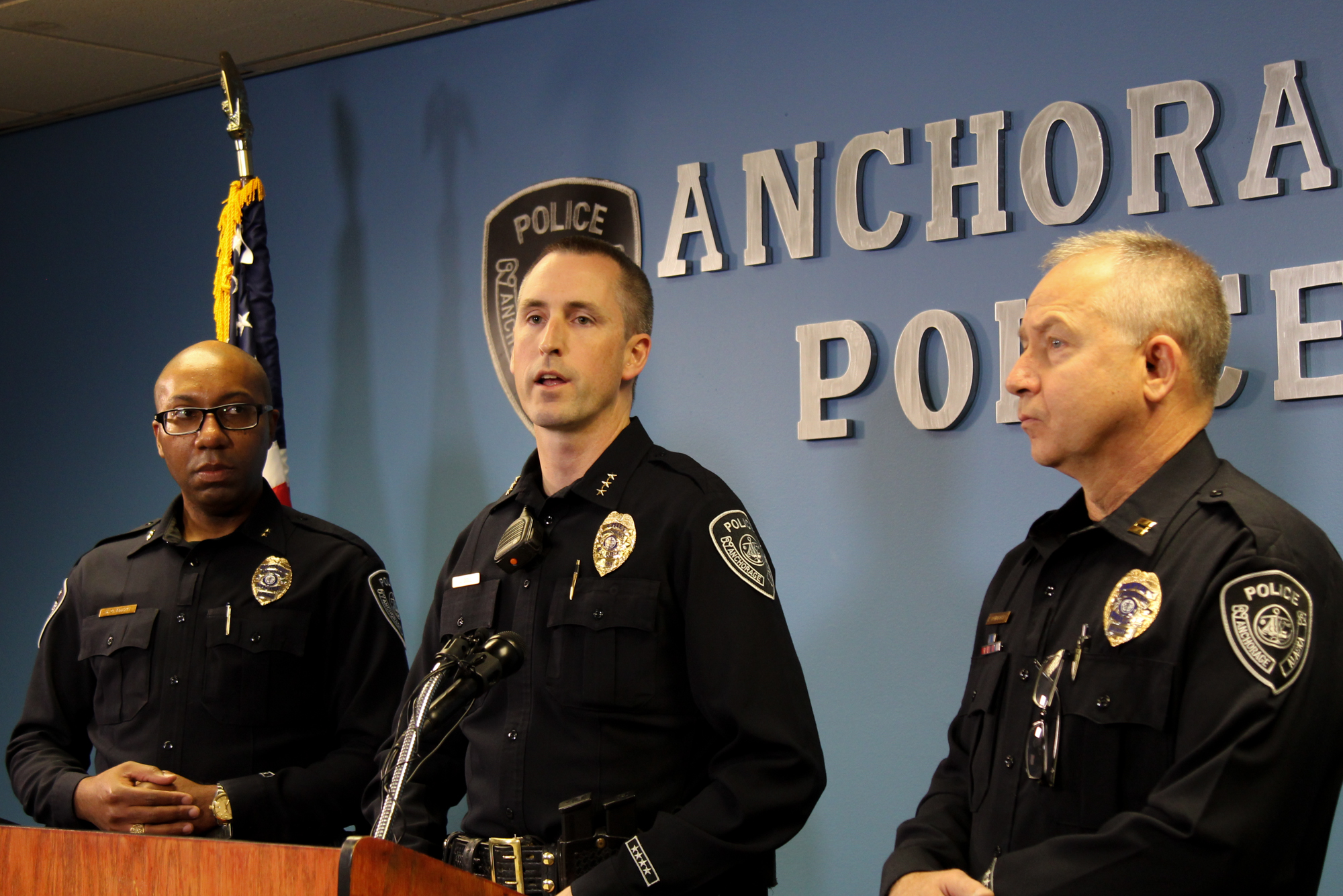 Anchorage police Capt. Ken McCoy, left, listens as Police Chief Justin Doll speaks about the Anchorage Police Department's new crime suppression strategy at departmetn headquarters next to Lt. Kevin Vandegriff. (Photo by Zachariah Hughes/Alaska Public Media)
