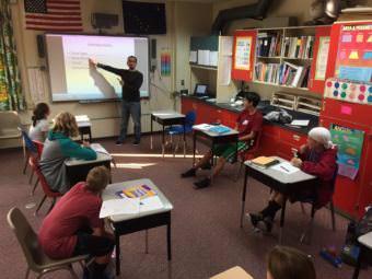Brandon Moonin teaches students Alutiiq in village of Tatitlek. (Photo courtesy of Brandon Moonin)