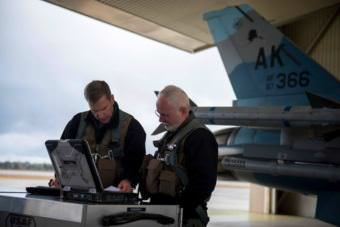 354th Fighter Wing Commander Col. David Mineau, left, and Fairbanks North Star Borough Mayor Karl Kassel prepare to fly in one of the F-16s at Eielson Air Force Base in October 2017.