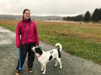 Courtney Wendel and her dog, Kiska, on the Airport Dike Trail. Wendel helped to get a second dumpster placed on the trail to help keep it clean.