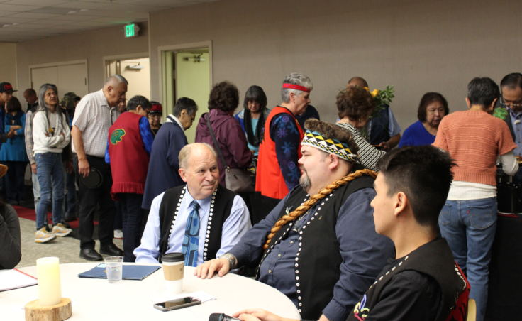Gov. Bill Walker talks with Central Council President Richard Peterson at the Indigenous Peoples Day celebration Oct. 9, 2017, at Elizabeth Peratrovich Hall. (Photo by Adelyn Baxter/KTOO)