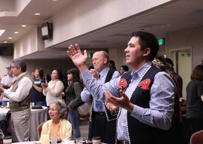 Ethel Lund, Gov. Bill Walker and Sealaska President and CEO Anthony Mallott react to performances at the Indigenous Peoples Day celebration at Elizabeth Peratrovich Hall on Oct. 9, 2017. (Photo by Adelyn Baxter)