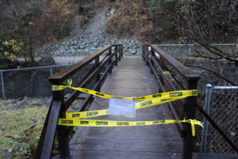 Caution tape blocks off the entrance to the Flume Trail off Basin Road on Oct. 29, 2017. (Photo by Adelyn Baxter/KTOO)