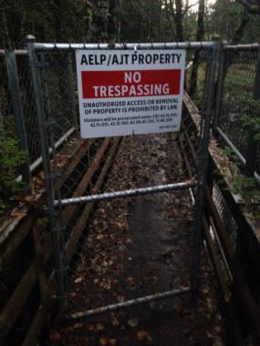 No trespassing signs mark a popular trail at the end of North Douglas Highway on Sept. 28, 2017. The signs were recently re-posted at the request of landowner Goldbelt, Inc.
