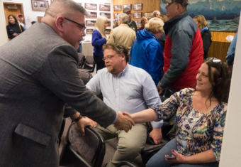 Juneau Assembly challenger Rob Edwardson and incumbent Debbie White shake hands after unofficial election results come in on Oct. 3, 2017. Edwardson won.