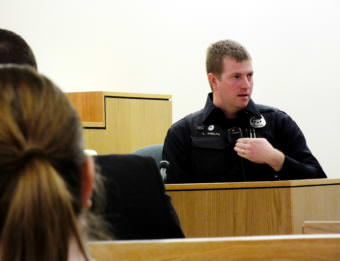 Juneau Police Officer Lee Phelps describes his experience and background to the jury during the Christopher Strawn homicide trial on Oct. 11, 2017. (Photo by Matt Miller)