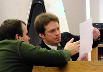 Stand-by counsel Nicholas Polasky, left, confers with Christopher Strawn during his homicide trial on Oct. 16, 2017.