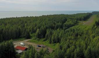 An old airstrip and work camp are being used in the effort to develop mineral deposits at Icy Cape. The Alaska Mental Health Trust Land Office owns the land and mineral rights and is overseeing exploration. (Photo courtesy The Alaska Mental Health Trust Land Office)