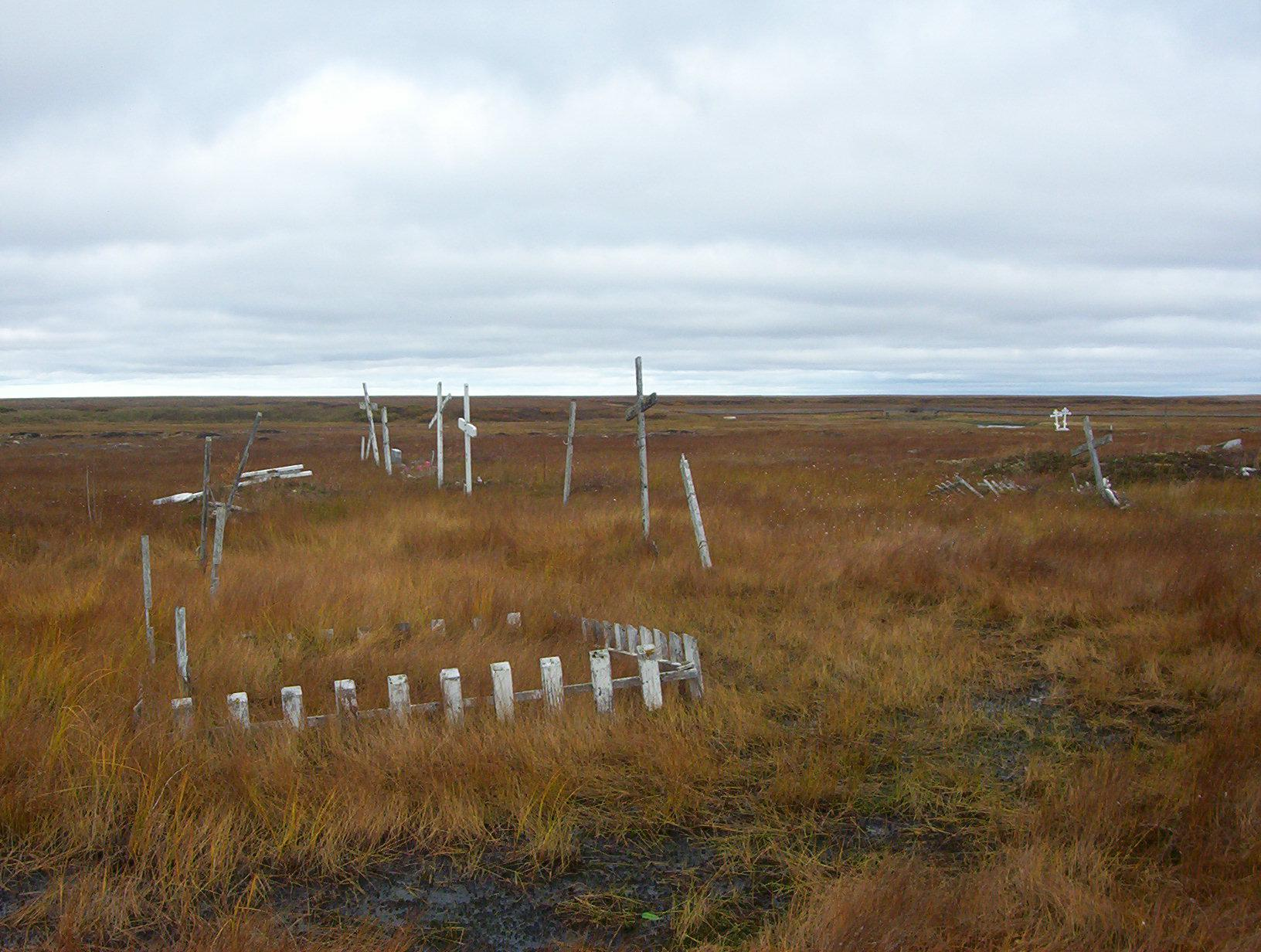 As the permafrost thaws, Kongiganak's cemetery is turning into swampland. Community members are now laying their loved ones to rest on raised platforms above ground. (Photo Teresa Cotsirilos/KYUK)