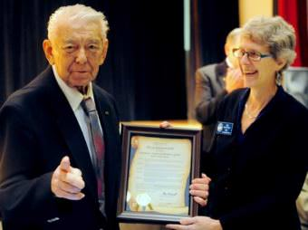 Herb Didrickson accepts a proclamation from Sitka Mayor Mim McConnell at banquet honoring his induction into the Alaska Sports Hall of Fame in 2012. The gymnasium at the Hames Center is named for Didrickson. (Photo courtesy Dan Evans)