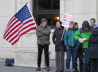 Juneau residents protest President Donald Trump's immigration policy outside the Alaska State Capitol on Feb. 6, 2017.
