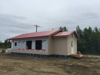 New teacher housing being built by high school students in Nikolai, Alaska in June. (Photo by Anne Hillman/Alaska Public Media)