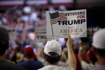 A man holds a sign supporting Donald Trump at a rally at Veterans Memorial Coliseum at the Arizona State Fairgrounds in Phoenix, Arizona, in June 2016.