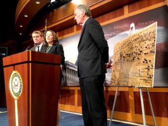 Sen. Michael Bennet, left, flanks Sen. Maria Cantwell with Sen. Ed Markey. (Photo by Liz Ruskin/Alaska Public Media)
