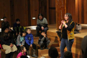 Culture Bearer Daaljíni Cruise tells Juneau second-graders a traditional Alaskan Native story during an excursion to the Walter Sobeloff Building on Nov. 16, 2017. (Photo by Adelyn Baxter/KTOO)
