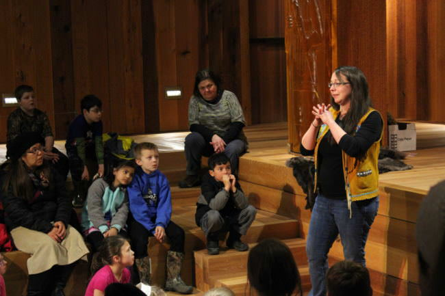 Culture Bearer Daaljíni Cruise tells Juneau second graders a traditional Alaskan Native story during an excursion to the Walter Sobeloff Building on Nov. 16, 2017. (Photo by Adelyn Baxter/KTOO)