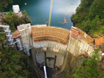 The Blue Lake dam under construction in September 2014. Half of all electric bills in Sitka now pay down the debt to build it. On the upside: Sitka has 40 percent excess capacity, and can afford to attract major industry. (Photo courtesy Desiree Brandis)