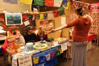 Kayla Simpson, Miguel Cordero and Mary Landes, members of Juneau Teens for Change sell treats and homemade goods at the 2017 Public Market. (Photo by Adelyn Baxter/KTOO)