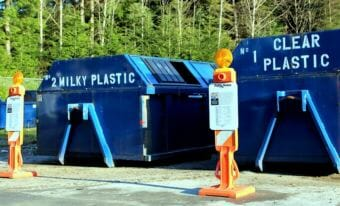 Sitka's recycling center has separate bins for different materials. But mixed paper containers are gone, due to new restrictions tied to import rules in China. (Photo by Robert Woolsey/KCAW)