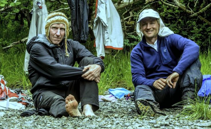 "The secret is in the feet. Dan Evans, 56, left, and Eric Speck, 48, relied on ""game wisdom"" to find routes through the rugged valleys of Baranof Island. But they also applied common sense: They built large fires almost every night (even in the rain) to dry out their boots. (Photo courtesy Dan Evans)"