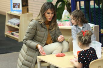 First Lady Melania Trump rolls a ball of Play-Doh to one of the military children at Joint Base Elmendorf-Richardson in Anchorage. (Photo by Wesley Early/Alaska Public Media)