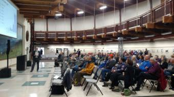 About 130 people showed up at the first Sandbox Group Meeting at Pioneer Park's Exhibition Hall. The second meeting, which drew about 70, began at 6 p.m. and ended after 10, due to an extended question-and-answer period. (Photo by Tim Ellis/KUAC)