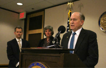 Alaska Gov. Bill Walker talks about his budget proposal in Anchorage on Dec. 15, 2017, as Revenue Commissioner Sheldon Fisher and budget director Pat Pitney look on. The budget for the fiscal year that begins in July 2018 would draw from Permanent Fund earnings. (Photo by Wesley Early/Alaska Public Media)