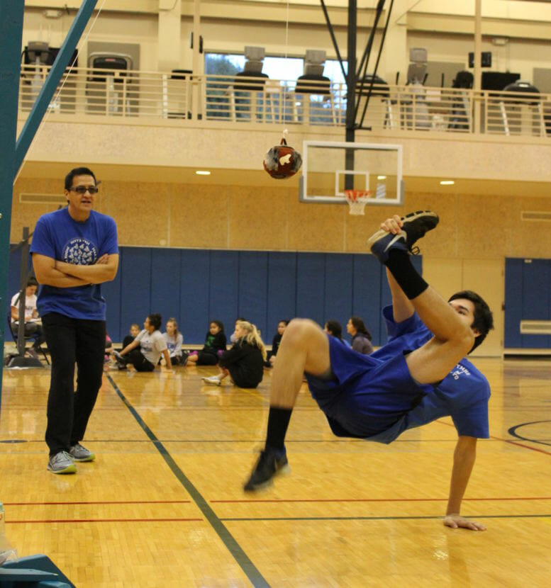 Thunder Mountain High School senior Josh Sheakley attempts the Alaskan High Kick at a community event at UAS. (Photo by Adelyn Baxter/KTOO)