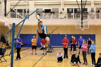 Kyle Worl demonstrates the One Foot High Kick, and event in the Native Youth Olympics. (Photo by Adelyn Baxter/KTOO)
