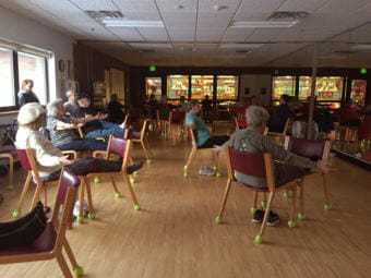 The chair yoga class at the Anchorage Senior Activity Center. (Photo by Anne Hillman/Alaska Public Media)