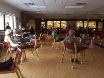 The chair yoga class at the Anchorage Senior Activity Center. (Photo by Anne Hillman/Alaska Public Media)