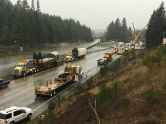Heavy lift cranes have removed the two Amtrak rail cars that were dangling over the lanes of southbound I-5 from a railroad overpass in DuPont, Washington. (Photo by Tom Banse/Northwest News Network)