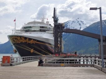 A Disney cruise ship is tied up at Skagway's ore dock. (Photo by Emily Files/KHNS)