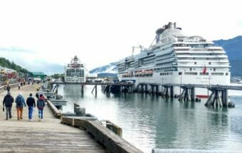 A pair of Panamax cruise ships docked in downtown Juneau on Aug. 30, 2017. The floating berths have eliminated the need for yellow security fencing and opened up a wide promenade for pedestrians. (Photo by Jacob Resneck/KTOO)