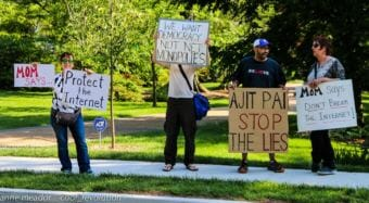 Protesters demonstrate in favor of net neutrality near the home of Federal Communications Commission Chairman Ajit Pai in May 2017. Some Alaska officials are looking at what they can do to restore the Obama-era policy.