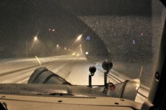 A view from the front seat of a DOT plow truck as it makes its way south on Egan Drive. (Photo by Adelyn Baxter/KTOO)