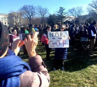 A crowd gathered outside the U.S. Capitol to protest the Republican tax bill. (Photo by Liz Ruskin/Alaska Public Media)