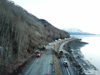 Alaska Department of Transportation crews work to clear a landslide that covered a portion of Seward Highway, near mile marker 105. (Photo courtesy Alaska Department of Transportation)