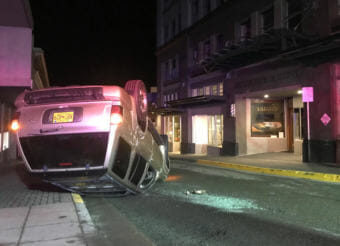 A 1999 gold Infinity SUV crashed Thursday night near Second and Seward streets in downtown Juneau. The driver and a passenger were taken to Bartlett Regional Hospital for treatment of their injuries. (Photo courtesy Justin Byrd)